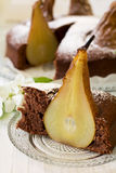 Piece of homemade chocolate cake with pears decorated pear blossom Stock Photo