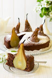 Piece of homemade chocolate cake with pears decorated pear blossom Royalty Free Stock Photography
