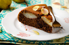 Piece of homemade chocolate cake with pears Royalty Free Stock Photo