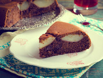 Piece of homemade chocolate cake with pears Stock Images