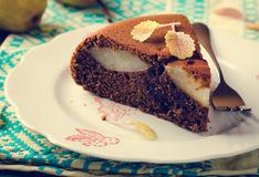 Piece of homemade chocolate cake with pears Stock Photos