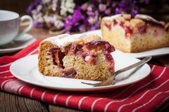 Piece of homemade fresh plum cake. Stock Photography