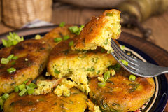 Piece of homemade fried pea chikpea fritter on fork Royalty Free Stock Photos