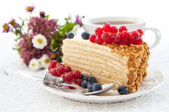 Piece of homemade honey cake with fresh berries Stock Photos