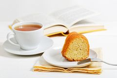 Piece of homemade lemon cake and cup of tea stock photography