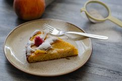 Piece of homemade peaches pie on a plate. Selective focus. royalty free stock photo