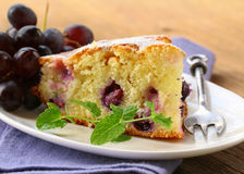 Piece of homemade sweet pie with grapes Stock Image