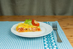 Piece of homemade tart hearty puff pastry with sausage Stock Image