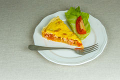 Piece of homemade tart puff pastry stuffed with sausage, tomato Royalty Free Stock Image