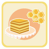 Piece of honey cake and bee on honeycomb Royalty Free Stock Photography