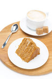 Piece of honey cake and a cup of cappuccino on wooden board Royalty Free Stock Image