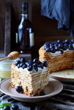 Piece of honey cake decorated with blueberry Stock Image