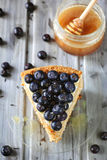 Piece of honey cake decorated with blueberry Royalty Free Stock Photography
