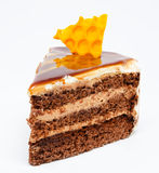 Piece of honey cake isolated on a white Stock Images
