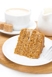Piece of honey cake on a plate and cup of cappuccino Stock Images