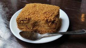 Piece of honey cake on the table stock footage