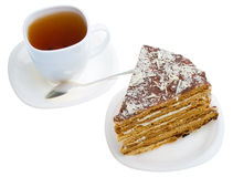 Piece of honey cake and tea cup Stock Image