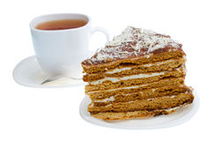 Piece of honey cake and tea cup Stock Photography