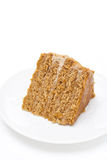 Piece of honey cake on a white background Stock Images