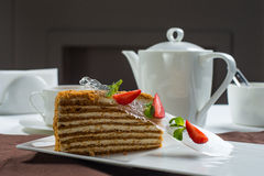 Piece of honey cake Stock Photography