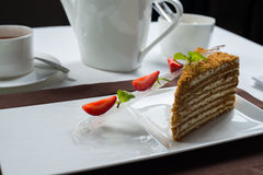 Piece of honey cake Royalty Free Stock Image