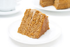 Piece of honey cake on a white plate, horizontal Royalty Free Stock Image