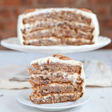 A piece of Hummingbird cake with pecans Stock Photo