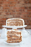 A piece of Hummingbird cake with pecans Stock Images