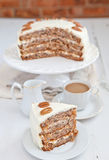 A piece of Hummingbird cake with pecans Royalty Free Stock Photography