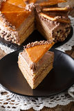 Piece of Hungarian Dobos cake with caramel close-up. vertical Royalty Free Stock Images