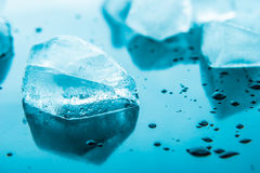 Piece of ice on the blue background  horizontal Royalty Free Stock Images