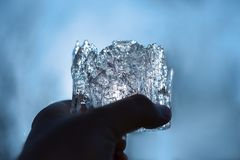 A piece of ice in hand. Fragile clear ice Stock Images