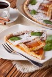 Piece of Italian tart with apricot jam and coffee, vertical Stock Images