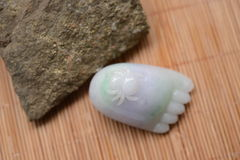 A piece of jade with the shape of feet Royalty Free Stock Photo