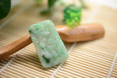 A piece of jade with wintersweet pattern Royalty Free Stock Image