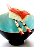 A piece of Japanese sushi with a slice of preserved ginger. Concept of well balanced diet. A piece of Japanese sushi with a slice of preserved ginger, balanced Royalty Free Stock Images