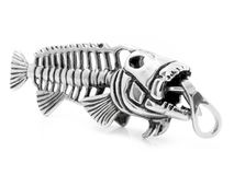 Piece of jewelry - a Pendant on the neck - Skeleton fish Piranha. Stainless steel Royalty Free Stock Image