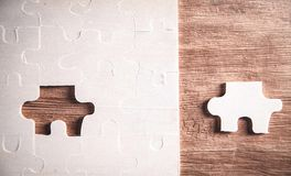 Piece of the jigsaw puzzle. Concept of business challenge completion stock photo