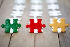 Piece of jigsaw puzzle On the old wood . teamwork concept.  symbol of association and connection. business strategy stock photography