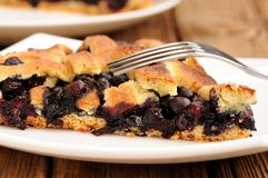 Piece of juicy homemade lattice pie with whole wild blueberries Stock Photography