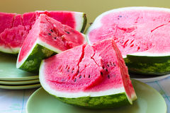A piece of juicy ripe watermelon with fleshy pink flesh on a lig Royalty Free Stock Image