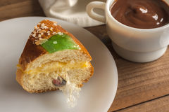 Piece of Kings cake Roscon de Reyes with surprise Royalty Free Stock Photos