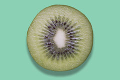 Piece of kiwi on colorful background. Piece of kiwi on a colorful background Stock Image
