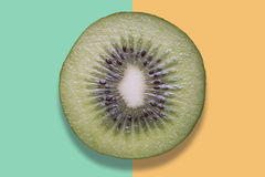 Piece of kiwi on colorful background Stock Photography