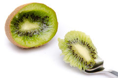 Piece of kiwi on a spoon Stock Photos