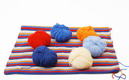 Piece of knitted cloth with cleus. Stock Image