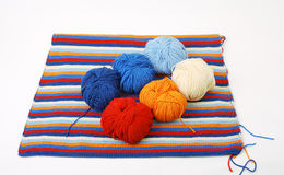 Piece of knitted cloth with cleus. Royalty Free Stock Image