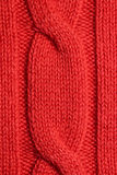 A piece of knitting orange sweater. Warm winter sweater close-up Royalty Free Stock Images