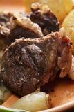 Piece of lamb chop closeup Stock Photos
