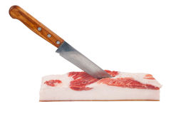 Piece of lard with knife Royalty Free Stock Photo